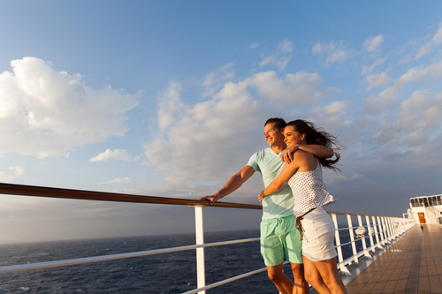 a couple enjoying the view from the deck of a cruise ship in the Caribbean